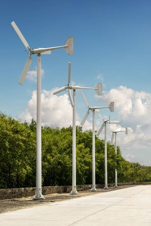 Group of wind turbine stand in a line on blue sky background Standard-Bild - 124810636