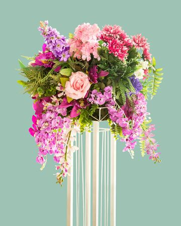 Bouquet of flower on metal stand for decoration isolated on green background with clipping path