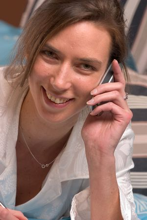 Laughing on the phone Banco de Imagens