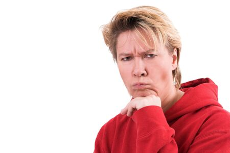 Woman looking very grumpy on white background photo