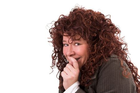 Pretty woman hiding her mouth behind her hand in a shy gesture Stock Photo - 649192