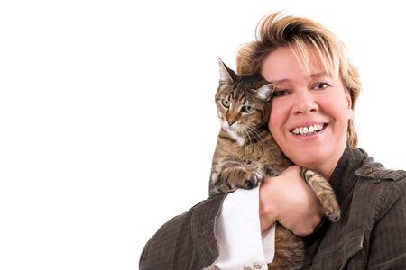 Blond woman posing with her cat on white background photo