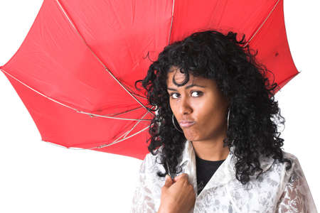 Beautiful brazilian girl looking very unhappy with a broken umbrella above her head photo