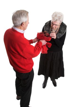 Elderly man giving his wife flowers for Valentines day Stock Photo - 743681