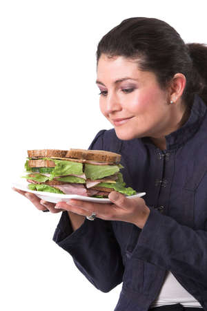 clearly: Pretty brunette looking to her sandwich, clearly looking forward to eating it