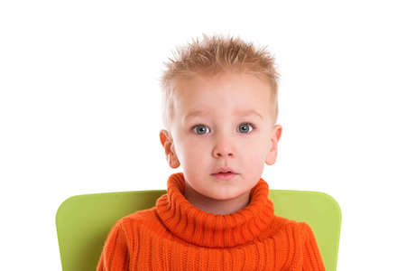 Cute young boy with big eyes on white background Stock Photo