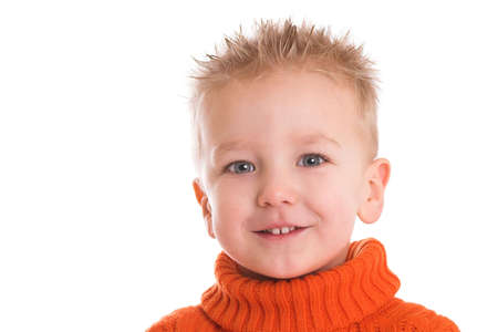Cute young boy with orange turtleneck on white background