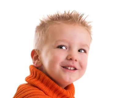 Cute two year old boy with a cheeky grin on his face photo