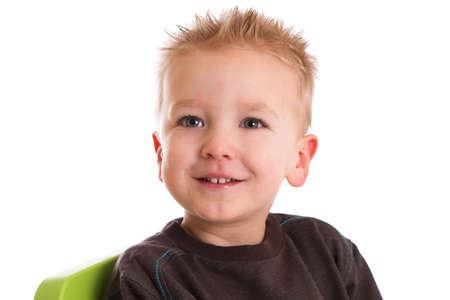 Two year old boying sitting with a smile