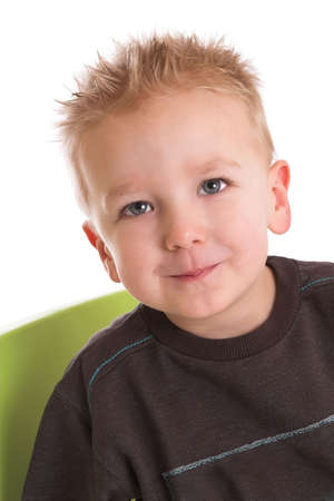 Cute two year old boy with a little shy smile Stock Photo - 837489