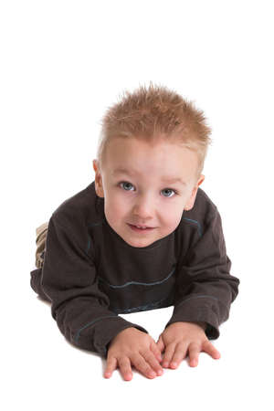 two year old: Cute two year old boy lying on the floor on white background Stock Photo
