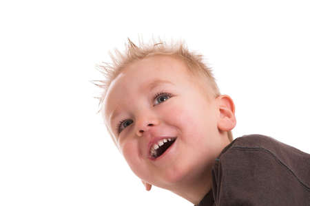 two year old: Two year old boy looking up with a big smile Stock Photo