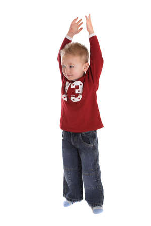 Two year old boy stretching his arms above his head photo