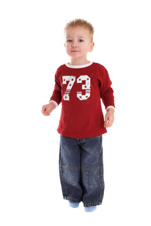 Cute two year old boy standing on white background photo