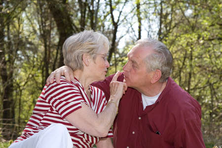 Sweet elderly couple outdoors on a hot summerday Stock Photo - 888614