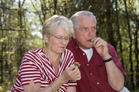 Sweet elderly couple having a fruitsnack Stock Photo - 888617