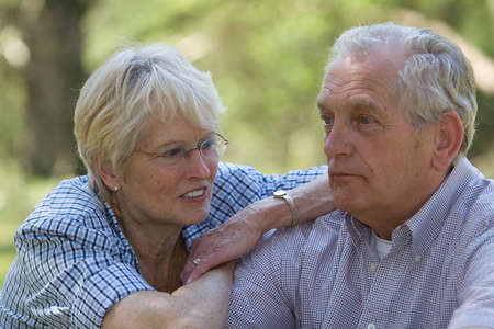 Lovely senior couple outdoors (shallow dof, focus on woman)