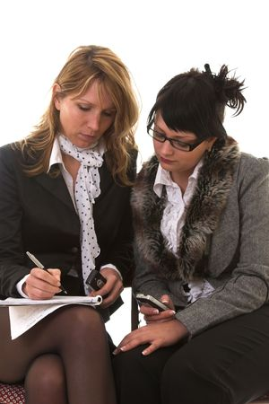 businessmeeting: Two women having a businessmeeting side by side