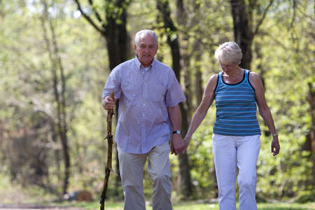 Senior couple out for a walk on a summerday Stock Photo
