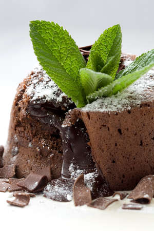 chocolaty: Delicious looking chocolate dessert with melted chocolate on the inside Stock Photo