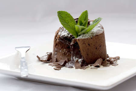 chocolaty: Delicious chocolate dessert served on a plate with cream and chocolate sprinkles