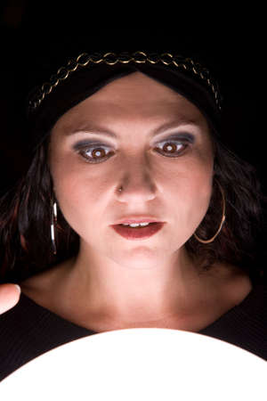 gypsy woman: Woman looking into her crystal ball and looking very shocked