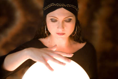 gypsy woman: Beautiful gypsy woman with her hand aboe her crystal ball Stock Photo
