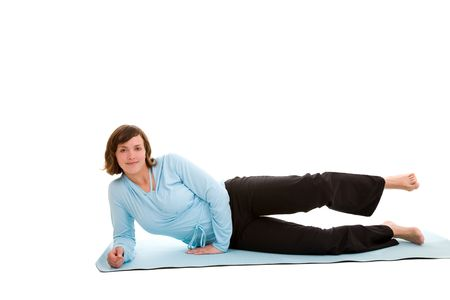 Woman doing exercises for her leg muscles lying on an exercise mat photo