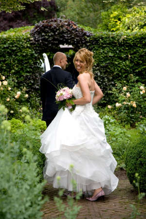 Beautiful blond bride turning around and sticking out her tongue Zdjęcie Seryjne
