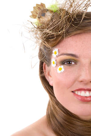 Beautiful woman with a birds nest on her head symbolizing spring season photo