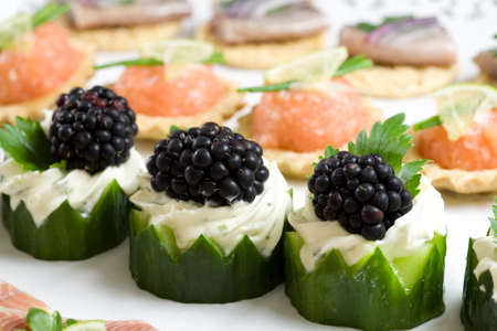 nibbles: Healthy and good looking party snacks served on a plate