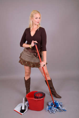 sexy skirt: Beautiful blond girl in sexy skirt mopping the floor