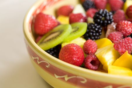 Delicious fruit salad in a bowl with strawberries and kiwi Stock Photo - 1312425