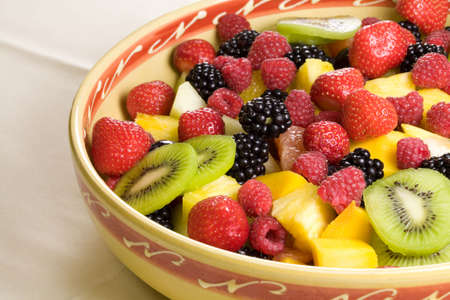 Delicious fruit salad served in a bowl photo
