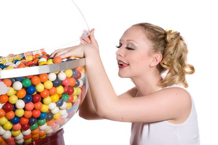 bubblegum: Pretty blond girl with ponytails reaching into the bubblegum container