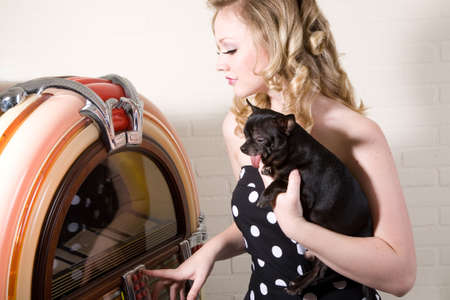 jukebox: Pretty blond girl with chihuahua on her arm