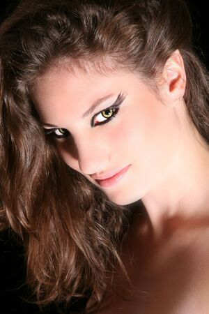 Beautiful woman with slightly pointed ears and wolverine eyes photo