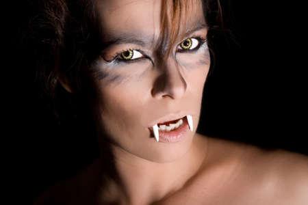 wolverine: Dangerous looking female vampire on black backgroundf