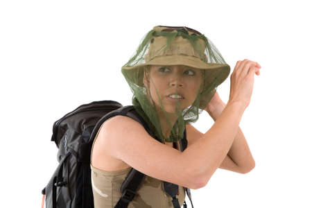 goes: pretty blond girl hiding her face behind a mosquito net that goes over her hat