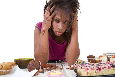 binge: Pretty black woman looking desperate after having had an eating binge