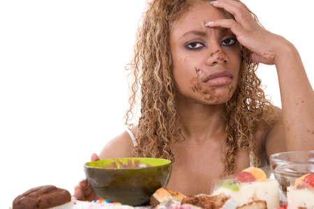 low self esteem: Pretty black woman looking very sick after having eating too much