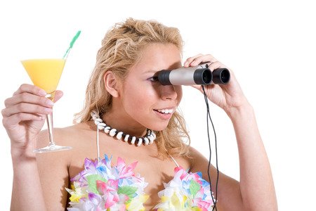 beautiful blond girl peering through her binoculars with cocktail in hand Stock Photo - 1573485