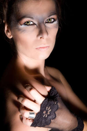 Beautiful woman with party contact lenses in all dressed up for  photo
