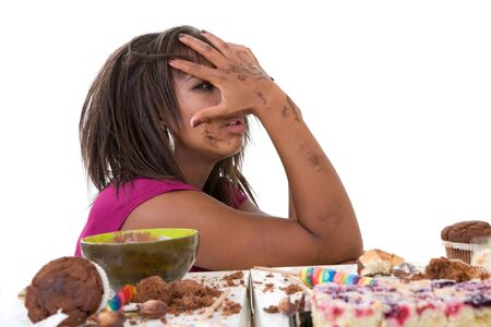 Pretty black woman having eating a pile of sweets and now looking nauseaus photo