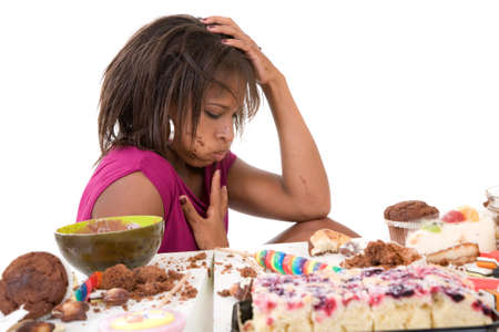 glutton: Pretty black looking very sick after having eaten too much sweets Stock Photo