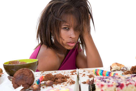 Pretty black woman looking nauseous after having eaten too much photo