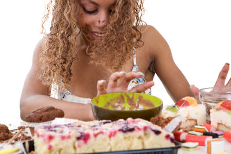 devouring: Pretty black girl pushing away the food she has just been devouring Stock Photo