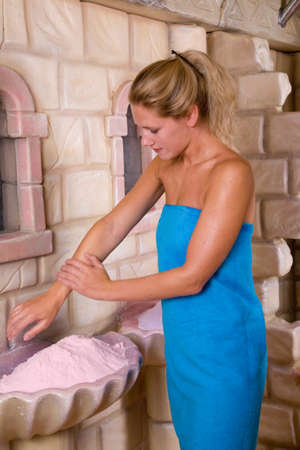 scrubbing: Pretty blond woman busy with scrubbing her skin Stock Photo