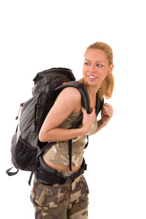 Beautiful young blond girl with backpack ready to travel