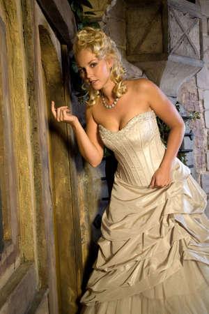 strapless: Beautiful blond girl with wedding dress signaling